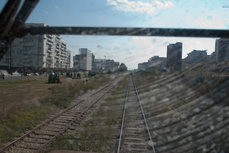 """We were invited up for a cab ride for the run round. This view is from the east looking back up towards the station. The line eastwards beyond the run round loop is disused but used to cross over the border to Nis in Serbia. The other crossing into Serbia is in the North via Mitrovice which is a stronghold of the Serb minority in Kosovo. An attempt to run a train between Serbia and Mitrovice in 2017 (complete with nationalist slogans) stirred up tensions: <a href=""""https://www.politico.eu/article/eu-kosovo-serbia-train-dispute-eu-mogherini-vucic-thaci/"""">https://www.politico.eu/article/eu-kosovo-serbia-train-dispute-eu-mogherini-vucic-thaci/</a>  <br /> <br /> There is no rail service on the Mitrovice route though Kosovo.  There is to the border on the Serbian side however."""