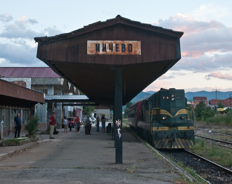 """Passenger services terminate at Kicevo.  The line was originally narrow gauge and extended through to Lake Ohrid. It was converted to standard gauge from Kicevo to Gostivar in the 1950s, and then as far as Kicevo in 1969 but the section onwards to Ohrid was closed. There's a remarkable account of what it was like to travel the line in the 1960s from Ohrid to <a href=""""http://www.penmorfa.com/JZ/ohrid.html"""">http://www.penmorfa.com/JZ/ohrid.html</a>. 'Trains took over seventeen hours from one terminal to the other and the little Feldbahns had to refill their tanks about every ten kilometres. We changed engines five times en route, sometimes from quaint-looking sub-sheds. Each of the 0-8-0Ts (JZ 99.4 series, 1914-1918) was the same class but each one had been radically individualised. Although the line once had an assortment of 0-4-0Ts and 0-6-0Ts, I did not see them.  Maximum speed was about 15km/h, so in order to see the whole line one had to catch the 15:30 mixed from Ohrid and sleep over at a village called Novo Selo.'"""
