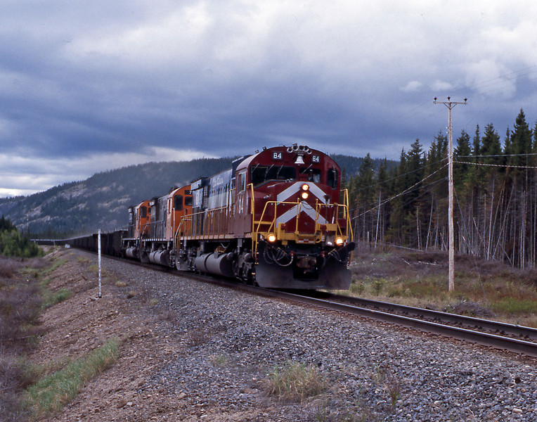 I waited and was eventually rewarded by a loaded train, this time behind 84, a 1975 M636 bult for the railroad.