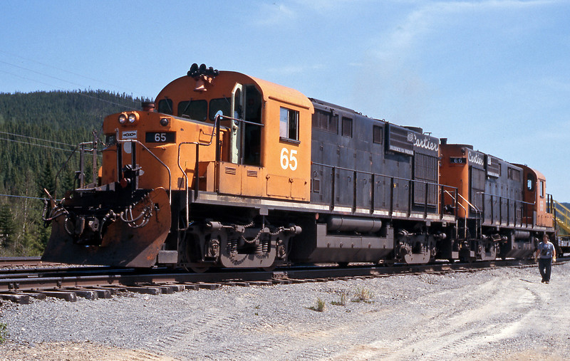 I stopped at a worksite at mp 34 on my way back down the dirt road to Port Cartier. 65 had returned without the MoW car and was burbling away with 66 in worktrain service