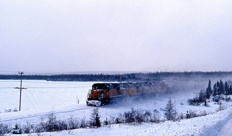 They were soon on the move, here passing a frozen lake enroute to Ross Bay Junction.
