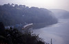 Just after dawn on the 19th and a Fowey bound train passes Golant as the mist rises off the river. the pictures was taken from our bedroom at the Cormorant Hotel