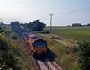 Near High Halstow on the Isle of Grain an early EWS intermodal service, the 4Z59 04:36 Ditton to Thamesport.