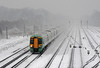 The snow returned on January 13th. At Gatwick Airport a London bound train approaches Platform 4