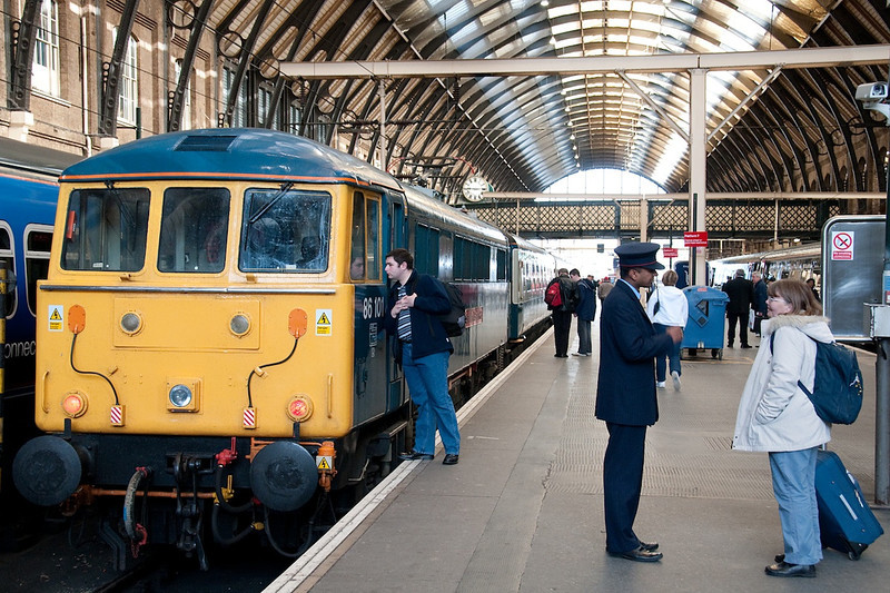 Yours truly at Kings Cross inspecting West Coast thoroughbred 86101 Sir William Stanier before taking up position for a trip with it on 1G03 09:34 to Doncaster, Hull Trains service, 12/4/2008. This picture appeared on one of the Phoenix Railway Photographic Circle's online gallery's a few years ago and was spotted by several friends of mine.<br /> Picture courtesy of Steve Arthur