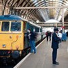 Yours truly at Kings Cross inspecting West Coast thoroughbred 86101 Sir William Stanier before taking up position for a trip onboard 1G03 09:34 Kings Cross to Doncaster Hull Trains service 12/4/2008. This picture appeared on one of the Phoenix Railway Photographic Circle online gallery's a few years ago and was spotted by several friends of mine.<br /> Picture courtesy of Steve Arthur