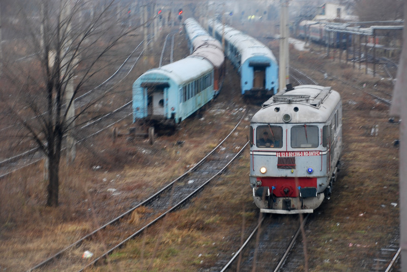 On rolling stock shunting duties at Iasi (in Eastern Romania) a battered class 60 Co-Co diesel electric built by Electroputere to a well-proportioned Swiss 'Sulzer' design. The prototypes (060-DA-001-6) were built in 1959 bt ALM/BBC/Sulzer. Over 1400 of these locomotives entered service with CFR from 1960 to 1981 and a fair amount remain.