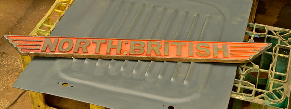 "The NBL radiator nameplate.<br /> There is some corrosion under the chrome .<br /> This will be sent to a specialist in Port Glasgow for  ""strip and re-coat"" of the chrome plating.<br /> 11th June 2016."