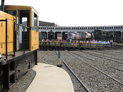 Schoolkids going for a ride on the turntable.