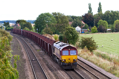66128 has just passed New Barnetby Crossing with 6T24 11.41 Immingham to Santon loaded Iron Ore. Friday 28th September 2012.