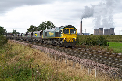 66520 passes Heck Ing crossing with loaded coal from Immingham to Drax Power Station. Thursday 27th September 2012.