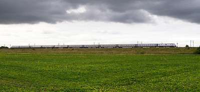 Under stormy skies a nortbound ECML service passes Heck. Thursday 27th September 2012.