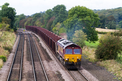 66061 heads 6K23 11.41 Santon to Immingham BSC Ore Terminal empties past Melton Ross. Friday 28th September 2012.