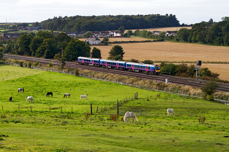 185149 heads away from Barnetby forming the 13.55 Manchester Airport to Cleethorpes. Friday 28th September 2012.