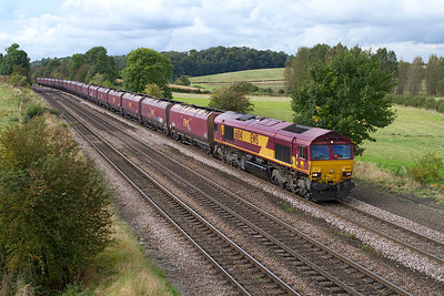 66041 passes Melton Ross with 4D07 10.55 Milford Sidings to Immingham empty HTA's. Wednesday 26th September 2012.