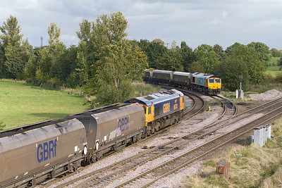 66702 'Blue Lightning' takes the Eggborough branch at Whitley Bridge Junction with 6C15 14.24 Immingham to Eggborough Power Station loaded coal as 66720 waits to leave. Thursday 27th September 2012.