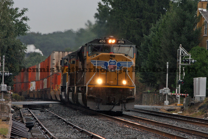 Norfolk Southern 212 led by three UP Locomotives passes a grade crossing in Fleetwood, PA