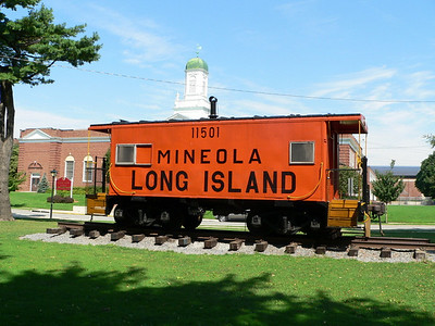 LIRR Caboose C-50 on display in Mineola Park before being moved to Oyster Bay.