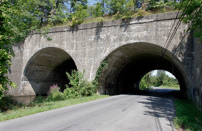 Double Arch bridge carried the Erie Graham line over the road and the Otter Kill in Orange County. Still in use today by NJT/Metro-North's Port Jervis line.