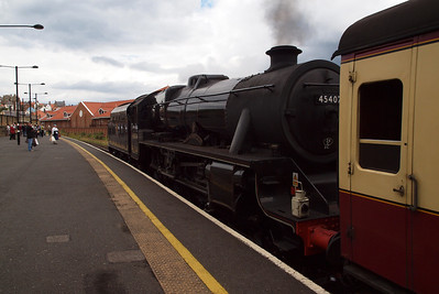 45407 propels the stock out of Whitby station in order to run round.