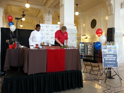 Chef Tom Douglas demonstrates his dishes for Amtrak.
