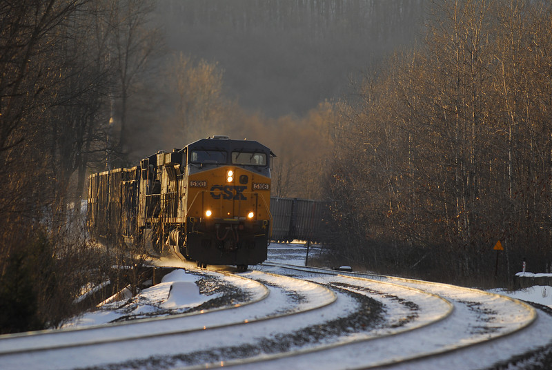 In the quickly dispearing light CSX Q426 heads downgrade past Middlefield station on Berkshire Sub.