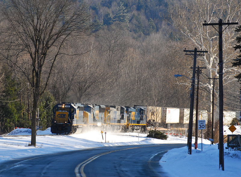 A lating running Q119 heads west along Rt 20 in Huntington with a GP40-2 leading.