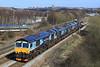 A Fine Light Engine move In The Sun,66434+66305+66302+20303+20309 Pass Gateshead Metro Centre on the 11.29 Doncaster-Carlisle Kingmoor on Monday,15th April 2013.
