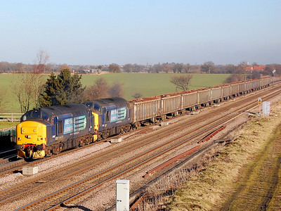 37688 37510 6z50 stockton to sheerness scrap passing colton junction 3 feb 2011.this was supposed to be my last day up north as was due back at work at 7pm in westbury that nite.how could i leave early when sun was shining(cough cough)hooray im staying.
