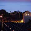 "Freight train passes Barnetby East signal box during the ""blue hour"". Red dots are the EOT device in motion."