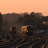 159 inbound passes 450 outbound in Basingstoke at sunset.