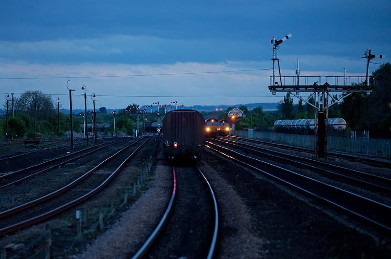 Three trains converge on Barnetby at night.