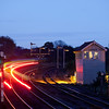 "First Transpennine Express passes Barnetby East signal box during the ""blue hour""."