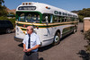 Rob from the Pacific Bus Association stands in front of a General Motors bus built in the 1950's.