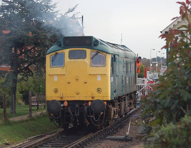 25057 setting out from the headshunt to run round the stock prior to forming the 1100 to Holt.