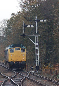 25057 by a fine pair of signals at Holt.