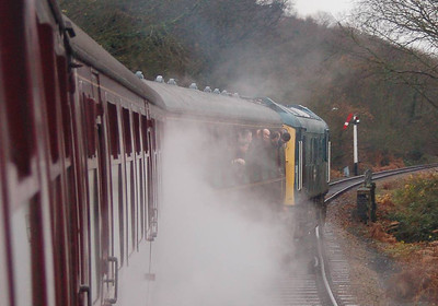 It was only when the loco joined the single line beyond the road bridge at Weybourne that it was visible through the steam.
