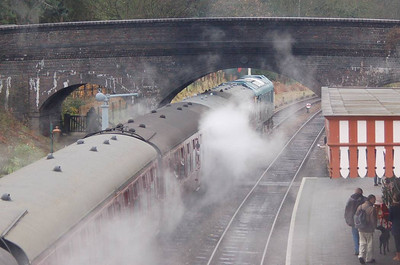 25057 disappearing under the road bridge at Weybourne with a train to Holt.