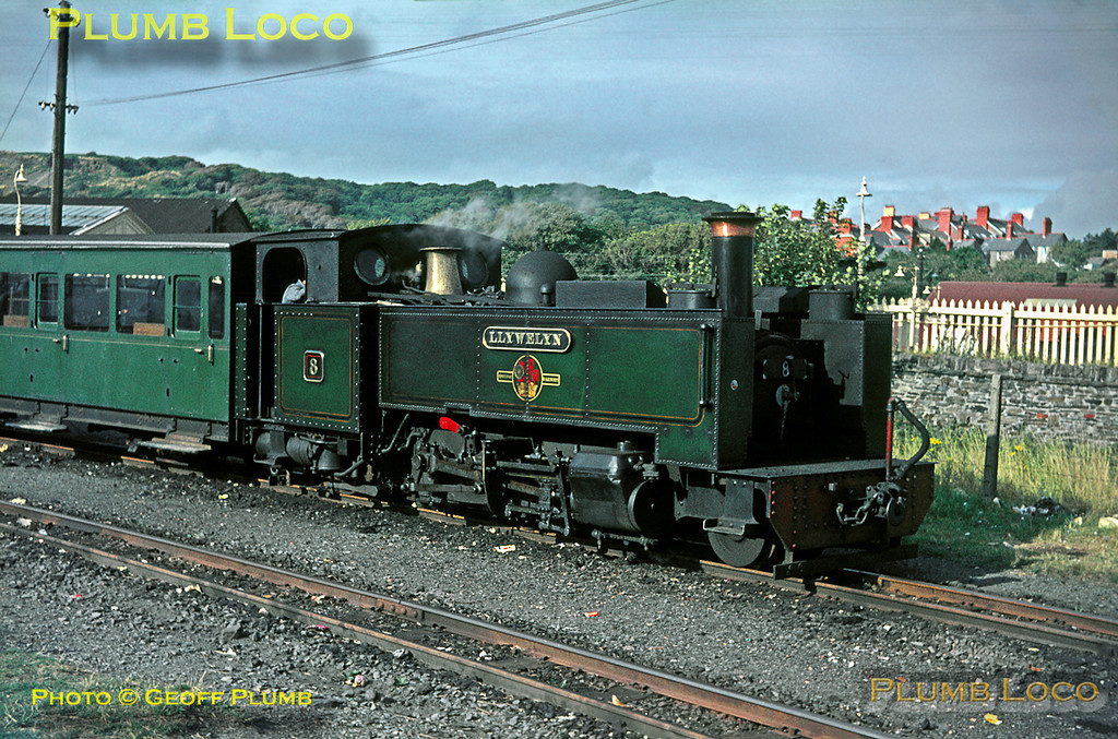 """Vale of Rheidol Railway. 1966/08/xx. Two foot gauge Vale of Rheidol Railway 2-6-2T No. 8 """"Llywelyn"""" waits for departure time in the narrow gauge station alongside the standard gauge station in Aberystwyth on a sunny afternoon in August 1966, before leaving for Devil's Bridge. Slide No. 2357."""