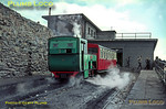 "Snowdon Mountain Railway. 1966/08/xx. For a change, the summit of Snowdon is clear of cloud as SMR No. 4 ""Snowdon"" stands in the summit station adjacent to the café, before descending to Llanberis once again. August 1966. Slide No. 2442."