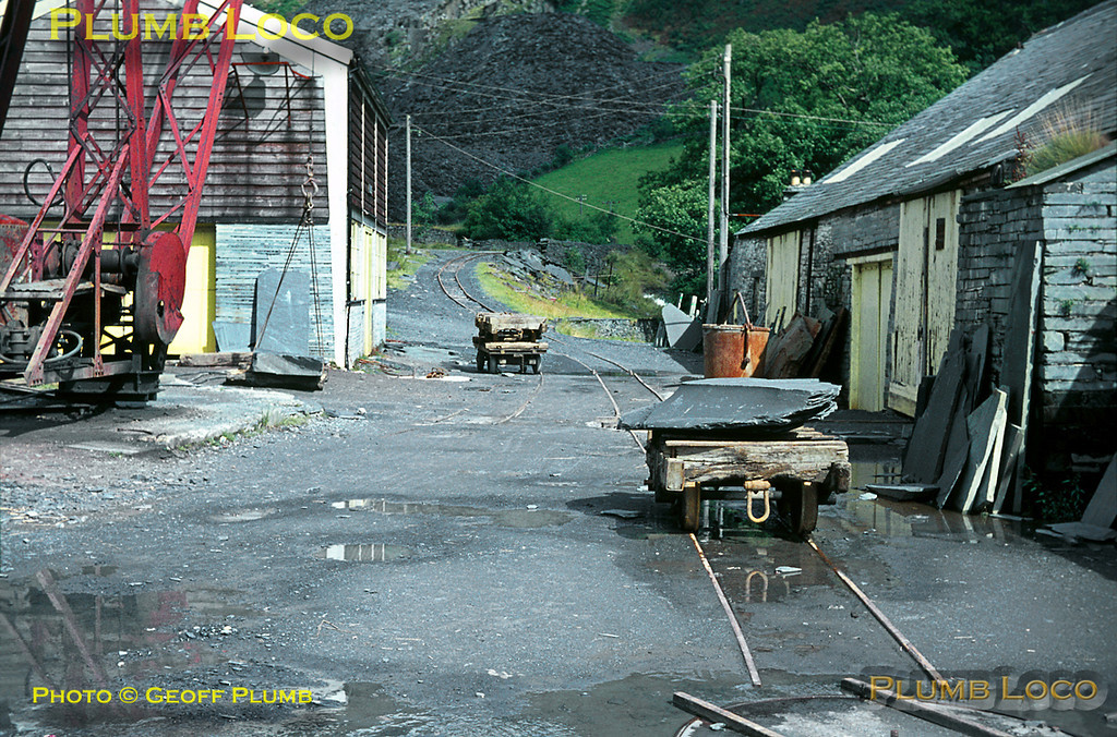"""Corris Railway. 1966/08/xx, 02. The section of 2' 3"""" quarry line from Aberllefenni quarry was still in use in August 1966, to transport large sections of slate to the cutting sheds to be trimmed into roof slates, note the wagon turntable in the foreground. Slide No. 2381."""