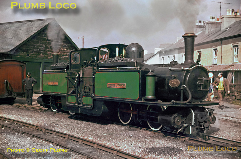 """Ffestiniog Railway. 1963/08/29. Double Fairlie 0-4-4-0T No. 10 """"Merddin Emrys"""" has run round its train at Porthmadog Harbour station after coaling and watering. Fireman Dave """"Rolo"""" Mackintosh waits to couple the engine to the train. The furthest right hand track was all that remained of the old connection to the Welsh Highland Railway, now re-connected! Thursday 29th August 1963. Slide No. 330."""