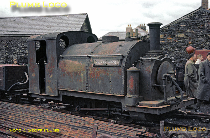 """Ffestiniog Railway. 1963/04/20. One of the George England 0-4-0STT engines is dumped in Glan-y-Mor yard on the seaward side of Boston Lodge works and shed across """"The Cob"""" from Porthmadog. It has the name """"Mountaineer"""" scrawled in chalk, but was this its actual identity? Photo taken in utterly foul conditions during a visit by the participants in the """"FR Society Special"""" from Paddington to Porthmadog, Saturday 20th April 1963. It is in fact """"Welsh Pony""""! Slide No. 25."""