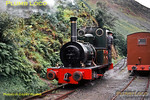"Talyllyn Railway. 1963/08/30. Talyllyn Railway No. 2 ""Dolgoch"" 0-4-0WT built by Fletcher Jennings and newly rebuilt in 1962-63 runs round its train at a rain-soaked Abergynolwyn before returning to Tywyn Wharf. The line from Abergynolwyn to Nantgwernol was still in situ at this time, but was in derelict condition, not being re-opened for some years. Friday 30th August 1963. Slide No. 338."