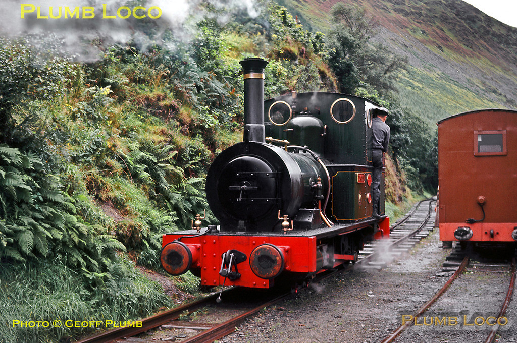 """Talyllyn Railway. 1963/08/30. Talyllyn Railway No. 2 """"Dolgoch"""" 0-4-0WT built by Fletcher Jennings and newly rebuilt in 1962-63 runs round its train at a rain-soaked Abergynolwyn before returning to Tywyn Wharf. The line from Abergynolwyn to Nantgwernol was still in situ at this time, but was in derelict condition, not being re-opened for some years. Friday 30th August 1963. Slide No. 338."""