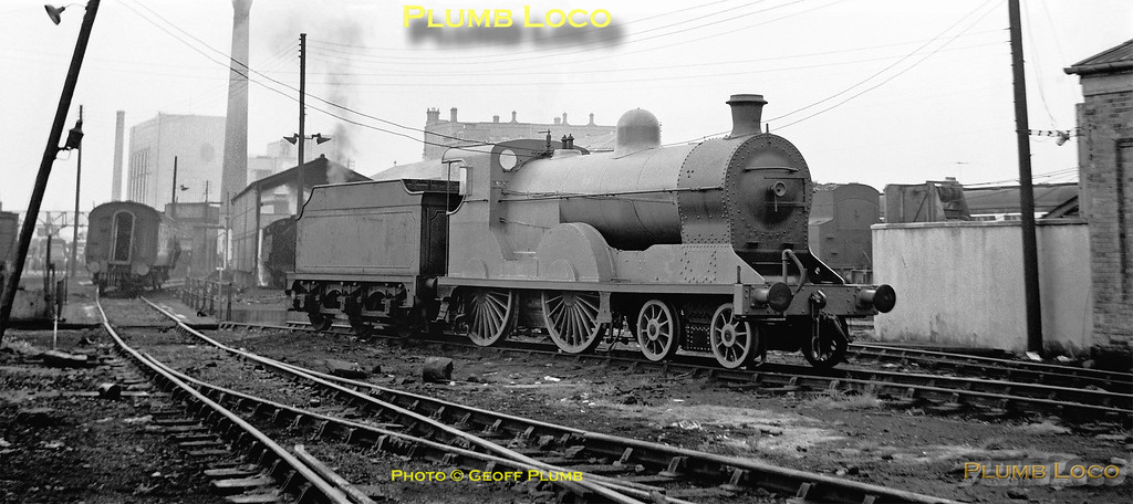 """Preserved ex-Great Northern Railway (Ireland) Class S 4-4-0 No. 171 """"Slieve Gullion"""" (Beyer, Peacock No. 5629/1913) had just undergone an overhaul at Harland & Wolff and is still in undercoat for its blue livery at Belfast York Road depot. The tender has also still to be repainted and will require turning before re-coupling to the engine! No. 171 was later based at the RPSI depot at Whitehead. September 1968."""