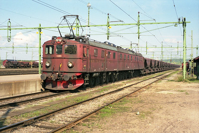 What a beast!  Dm/Dm3 class 1201+1231+1202 stands at Gällivare in Northern Sweden with an iron ore train from Kiruna, 8/6/95