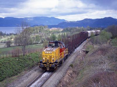 A day on the Nordlandsbanen; Di8.710 hauls a southbound freight near Skatval 29/5/97.