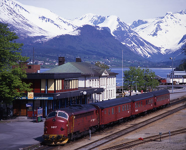 Åndalsnes station is in a delightful setting at the head of the Romsdalsfjorden.  3.617 waits to depart with the 16.30 to Dombås 31/5/97.