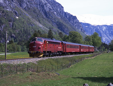 Train 351 the 12.25 Dombås - Åndalsnes is seen near journey's end at Mongefossen 31/5/97.